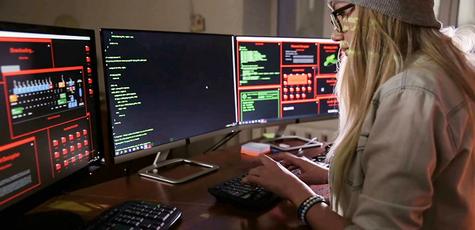 Female-computer-programmer-coding-hacking-in-dark-room_b9xkkk1be_thumbnail-full01